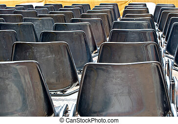 Chairs - Empty black Chairs for concert spectators