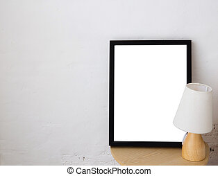 Empty black frame with place for text with lamp. Scandinavian hipster style room interior.