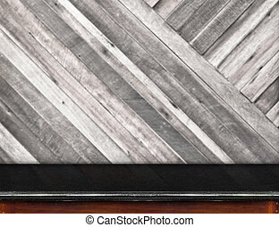 Empty black marble table and blurred diagonal plank wooden wall in background