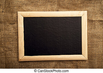 Empty blackboard on jute canvas