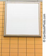 Empty blank square white advertising billboard on orange tiled wall