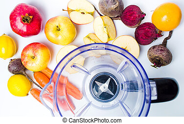Empty blender and various fruit for making a smoothie