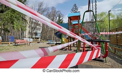 Chisinau, Moldova - March 27, 2020: Empty blaocked children playground in residential area during quarantine by reason of coronavirus AKA covid-19 virus threat. State of emergency declared in Moldova from March 17 until May 15