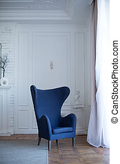 Empty blue armchair in classilal interior