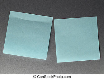 Empty blue paper sheet on refrigerator door.