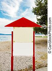 Empty board on the beach