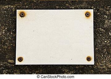 Empty board on wall