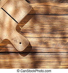 Empty board with fork and knife on wooden table