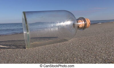 Empty bottle on the beach