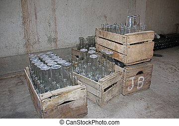 Empty bottles in wooden boxes