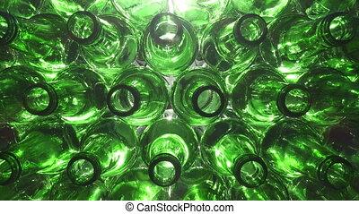 Empty bottles. Slider shot of empty glass bottles. Top view ...