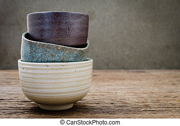 Empty bowl on rustic wood, Japanese handmade ceramic bowl, ceramic texture