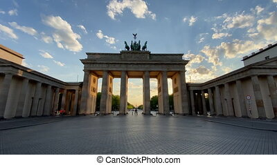Empty Brandenburg Gate Establishing Shot in Berlin, Germany with No People at Golden Hour Sunset during Coronavirus COVID-19 Pandemic 4K