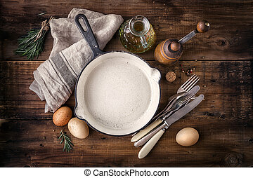 Empty cast iron skillet - Ingredients for cooking and empty ...