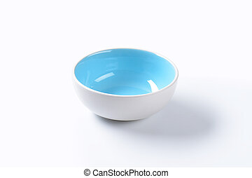 Empty ceramic bowl on white background