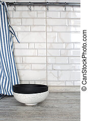 Empty ceramic bowls on a gray brick tale background