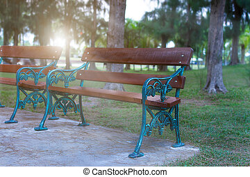 Empty chair at the park with lighting evening.