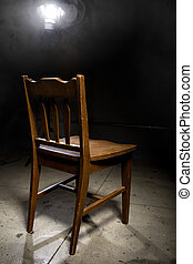 Empty Chair in an Interrogation Room - Isolated wooden chair...