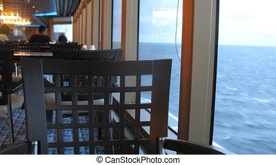 Empty chair in restaurant on cruise liner