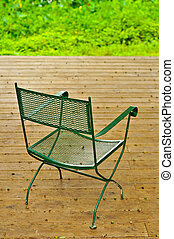 Empty chair on a wooden deck