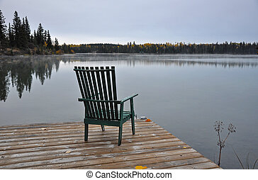 Empty chair on autumn morning