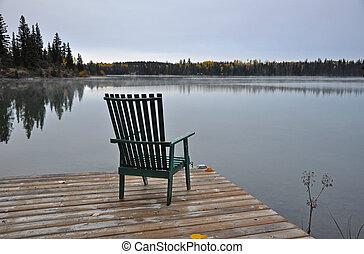 Empty chair on autumn morning