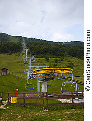 empty chairlift in the summer