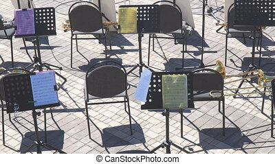 Empty chairs and notes on the music stand. Empty seats in...