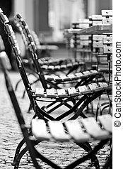 Empty chairs in beer garden