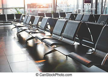 Empty chairs locating in wide airdrome hall