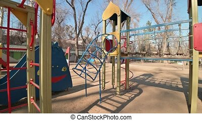 Chisinau, Moldova - March 17, 2020: Empty children playground in cathedral square park in the center of city during quarantine by reason of coronavirus AKA covid-19 virus threat. State of emergency declared in Moldova from March 17 until May 15