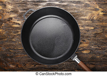clean cast iron skillet - empty clean cast iron skillet on a...