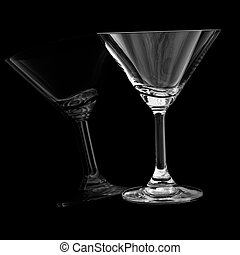 Empty cocktail glass on black