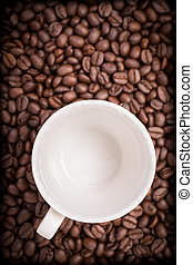 Empty coffee cup and coffee beans