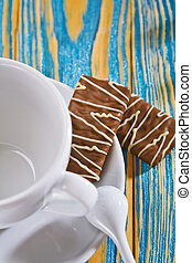 empty coffee cup and cookie