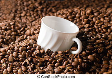 Empty coffee cup in beans