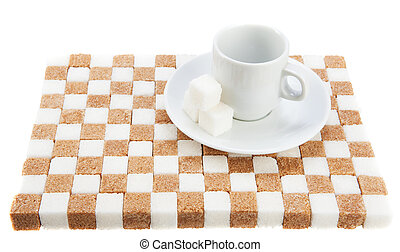 empty coffee cup on a saucer with three cubes of sugar on a stand of brown and white sugar