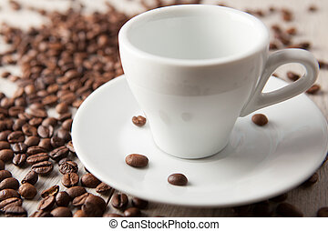 empty coffee cup with beans