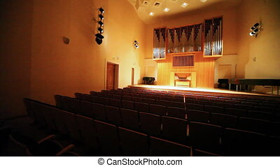 empty concert hall with large organ, panorama left to right