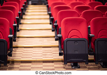 hall with rows of red seats
