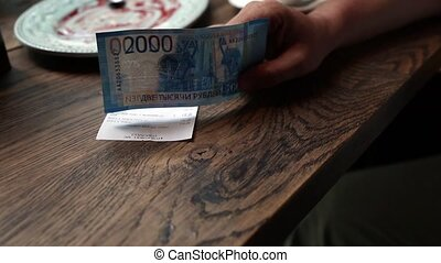 Empty Cup Of Black Coffee On Table And Russian banknotes...