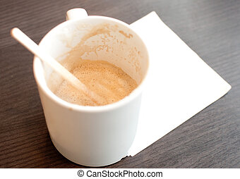 Empty cup of coffee with white napkin space for text