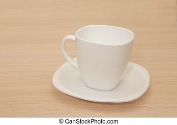 Empty cup on a wooden background