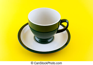 Empty cup on yellow background.