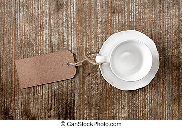 Empty cup with paper blank tag