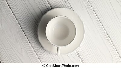 Empty cup with saucer - From above view of white empty cup...