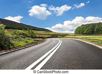 Empty curved road, Yorkshire, uk