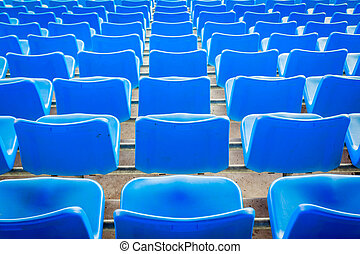 Empty dark blue chairs at the football Stadium