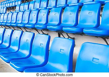 Empty dark blue chairs at the football Stadium