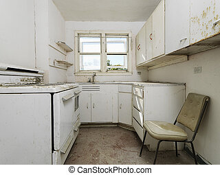 Forgotten empty abandoned dirty kitchen.
